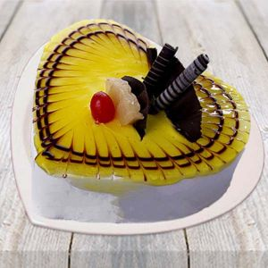 Half kg Lovely Pineapple Heart Shape Cake - Send Heart Shaped Cakes Online